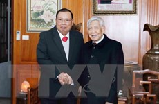 Tổng Bí thư Lào thăm nguyên Tổng Bí thư Lê Khả Phiêu và Nông Đức Mạnh