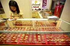 Giá vàng đi xuống trước số liệu khả quan về kinh tế Trung Quốc