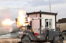 Nhóm vũ trang ở Iraq cảnh báo trả đũa các cuộc không kích của Mỹ