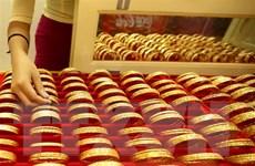 Giá vàng thế giới giảm xuống mức thấp nhất trong hơn một tháng