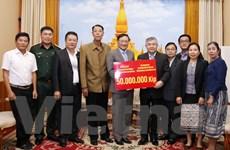 Người Việt tại Lào hỗ trợ người dân vùng lũ lụt ở Savannakhet