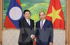 Giữ vững đà phát triển tốt đẹp của quan hệ đặc biệt Việt Nam-Lào