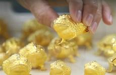 Giá vàng thị trường thế giới rơi khỏi mức 'đỉnh' của 5 tháng