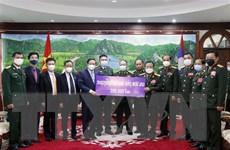 Bộ Quốc phòng Lào ủng hộ Quỹ phòng chống COVID-19 Việt Nam 200.000 USD
