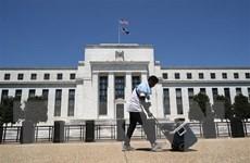 Fed có thể cắt giảm cùng lúc các chương trình mua tài sản
