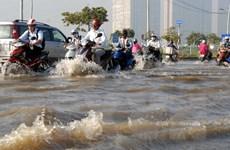 Người dân Thành phố Hồ Chí Minh: Khốn khổ đối phó triều cường