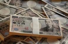 Đồng yen giảm giá sau khi BoJ hạ dự báo tăng trưởng, lạm phát