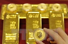 Bình luận từ các quan chức của Fed làm giá vàng thế giới đi xuống