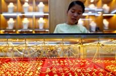 """Giá vàng tại châu Á trượt khỏi mức """"đỉnh"""" của hơn hai tháng"""