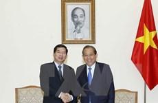 Phó Thủ tướng Trương Hòa Bình tiếp Chánh án Tòa án tối cao Lào