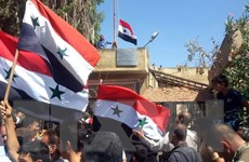 Quân đội Syria treo quốc kỳ tại vùng đệm giáp Cao nguyên Golan