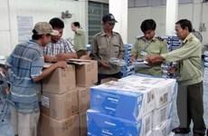 Bắt giữ hàng trăm thùng sữa không được phép lưu hành tại Việt Nam