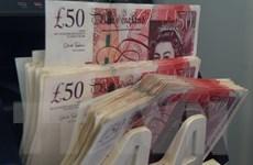 Đồng bảng Anh và đồng euro cùng rơi xuống các mức thấp kỷ lục