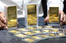 Giá vàng chịu sức ép đi xuống khi đàm phán Mỹ-Trung có tiến triển