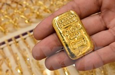 Giá vàng tại thị trường châu Á đi lên, trước sự yếu đi của đồng USD