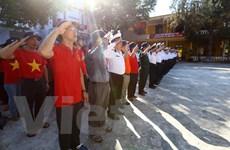 [Photo] Lễ chào cờ uy nghiêm trên đảo Sinh Tồn