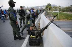Hình ảnh về cuộc bạo động do phe đối lập châm ngòi ở Venezuela
