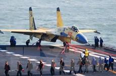 Tàu sân bay và máy bay J-15 TQ tập trận bắn đạn thật