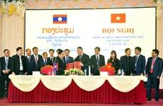 Ký biên bản hợp tác phát triển thương mại biên giới Việt Nam-Lào