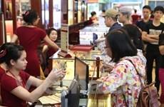 Giá vàng trong nước đi lên, tỷ giá trung tâm vượt 23.140 đồng