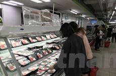 Thứ trưởng Bộ Nông nghiệp: Giá thịt lợn trong nước đã ''dịu xuống''