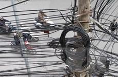 Hà Nội cắt bỏ hơn 10.000m dây, cáp treo trên cột điện