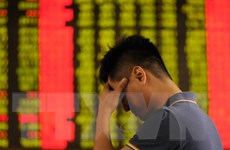 Chứng khoán châu Á đi xuống dù căng thẳng thương mại Mỹ-EU hạ nhiệt
