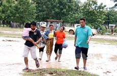 EVN hỗ trợ người dân Lào ở vùng ảnh hưởng sự cố đập thủy điện
