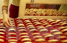 Giá vàng thị trường thế giới lên mức cao kỷ lục trong sáu năm