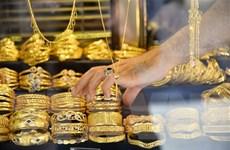 Giá vàng thế giới tăng 1% sau các số liệu kém lạc quan của Mỹ