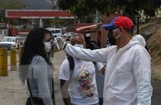 Venezuela kéo dài cách ly, Ecuador cắt giảm lương quan chức chính phủ