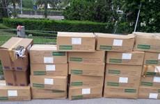 Phát hiện hơn 20 thùng thuốc tây hết hạn vứt bỏ trên Đại lộ Thăng Long