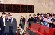 [Photo] Chủ tịch nước dự Lễ kỷ niệm 135 năm Ngày Quốc tế Lao động