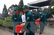Tiễn đưa hài cốt liệt sỹ quân tình nguyện Việt Nam tại Lào về nước