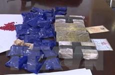 Bắt đối tượng mua bán 4 bánh heroin và 6.000 viên ma túy tổng hợp