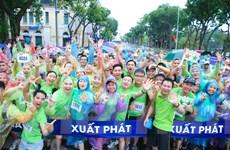 [Photo] Hàng ngàn người chạy dưới mưa ủng hộ cuộc sống xanh sạch đẹp