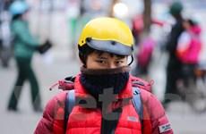 Học sinh Hà Nội trùm kín mít đi học dưới trời rét 10 độ