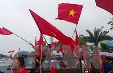 [Photo] ASIAD 2018: Người dân hân hoan đón chào Đoàn thể thao Việt Nam