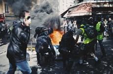 """Pháp: Cảnh sát sử dụng hơi cay nhằm vào người biểu tình """"Áo vàng"""""""