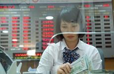 Tỷ giá USD tại các ngân hàng thương mại tăng mạnh tới 60 đồng