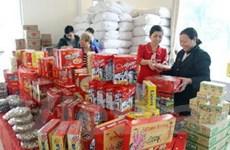 Hàng hóa phục vụ Tết tràn ngập, sức mua bắt đầu tăng