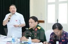 Các đại biểu Quốc hội thảo luận tổ về 2 dự án luật