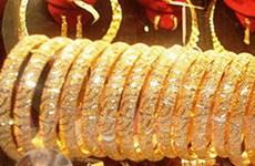 Giá vàng vọt lên trên 950 USD mỗi ounce