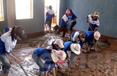 Tổ chức quốc tế hỗ trợ gần 7 tỷ đồng cho dân vùng lũ