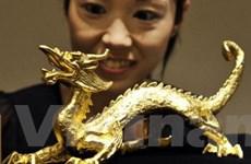 Giá vàng tại châu Á giảm nhẹ nhưng vẫn ở ngưỡng cao