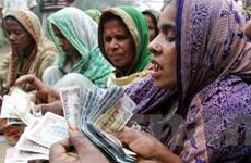 Muhammad Yunus và công cụ giúp thoát nghèo