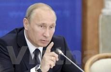"""Ông Putin lên án chính sách tiền tệ """"du côn"""" của Mỹ"""