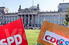 Bà Merkel bắt đầu đàm phán lập chính phủ với SPD