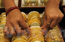 Giá vàng thị trường châu Á giảm bốn phiên liên tiếp
