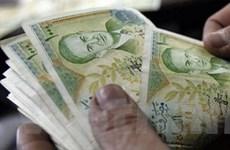 Chính phủ Syria nỗ lực khôi phục giá trị đồng nội tệ